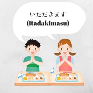deux enfants qui s'apprêtent à manger et disent itadakimasu en japonais.